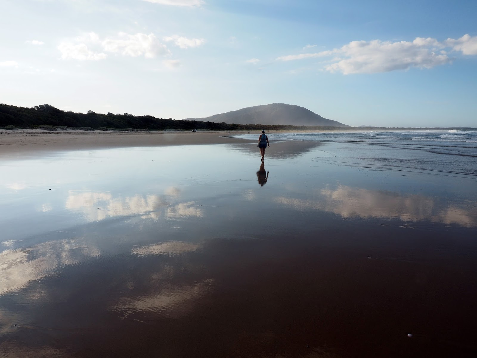 Girl walking on Diamond Head Beach