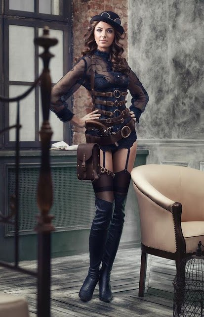 Black sheer sexy steampunk clothing and lingerie. Sheer black blouse, black corset, thigh high stockings, garter belt, knee high boots, bowler hat, goggles, harness and gun. Women's steampunk fashion.