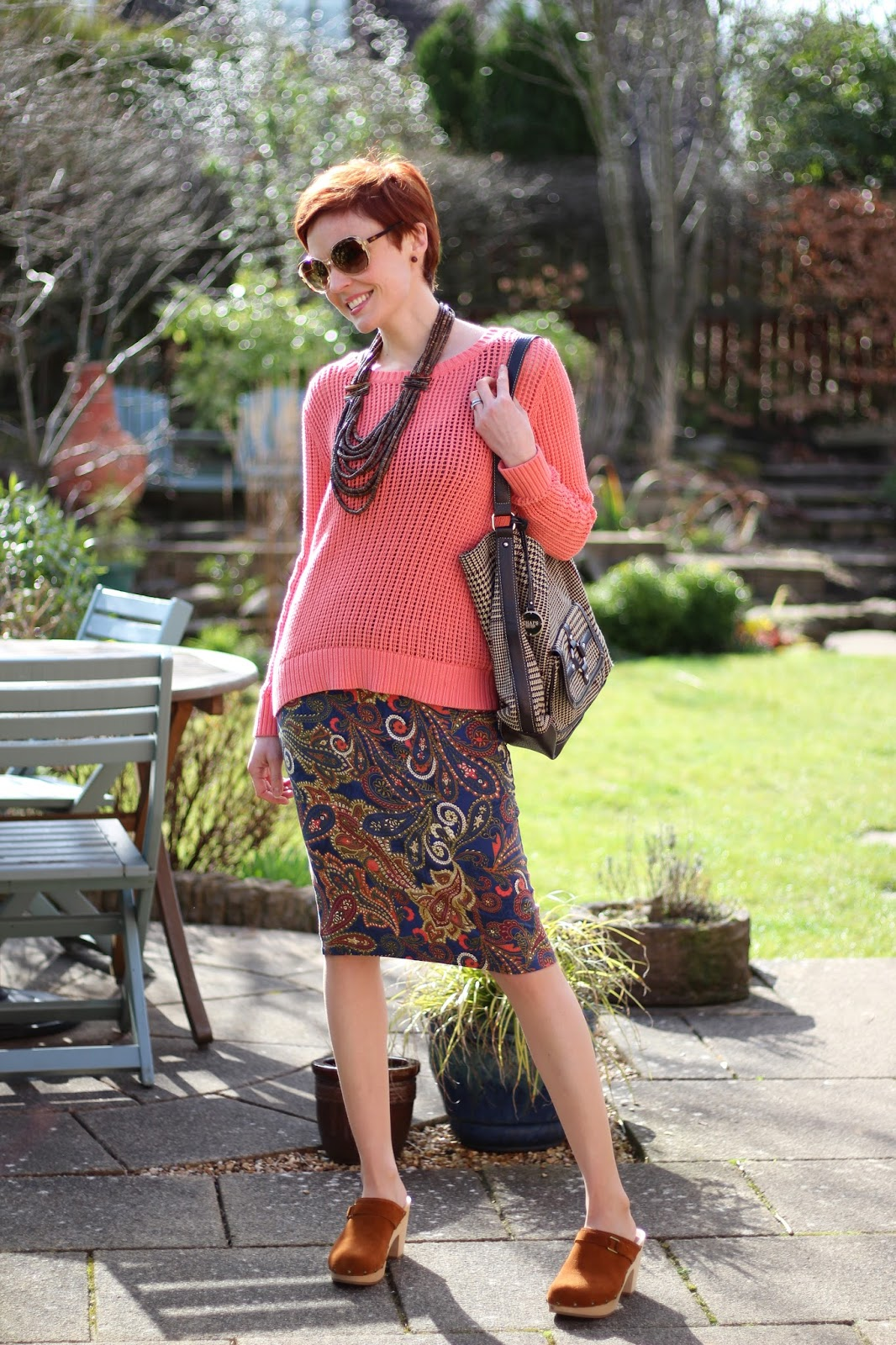 Fake Fabulous | Paisley pencil skirt, coral jumper, tweed bag and tan clogs.