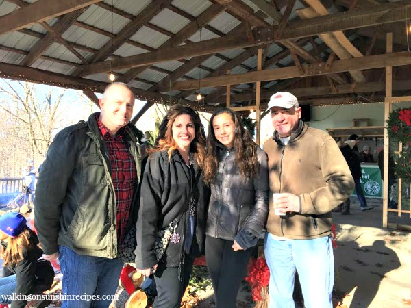 My husband, myself, my niece and my brother ready to find the perfect Christmas tree from Walking on Sunshine.