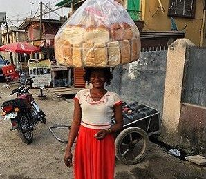 Woman Who Sells Bread On Street Photobombs A Superstar Resulting To Modeling Contract