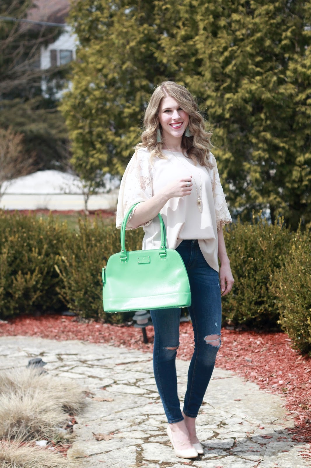 PinkBlush taupe lace sleeve blouse, distressed jeans, nude heels, green Kate Spade bag, mint tassel earrings