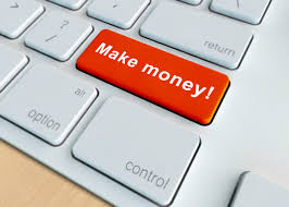 A laptop and a button of earn online