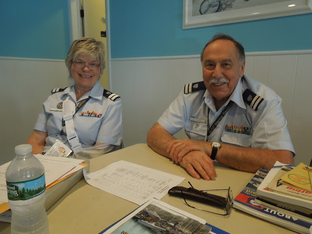 Janet Malzone and Bill Castagno prepared to check students in.