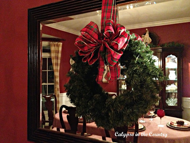 Wreath hung on mirror in dining room
