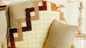 Manta con borde geométrico al crochet