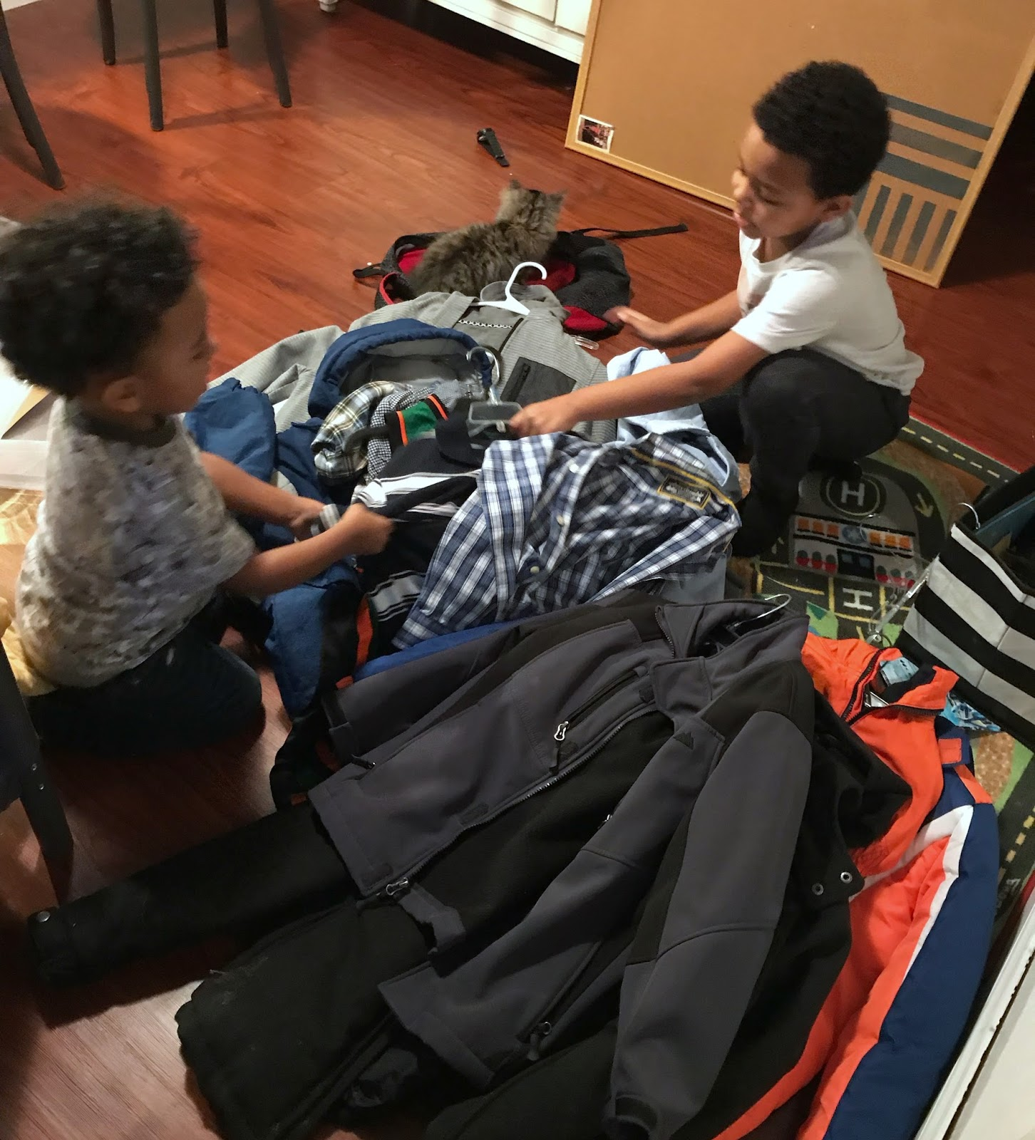 kids assisting in organizing clothes