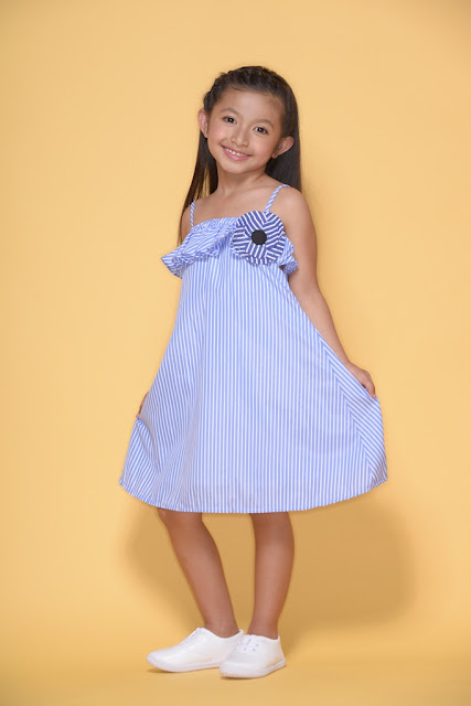 171d62ad5c4 Blue and white striped shift dress with spaghetti straps brings on the  charm.