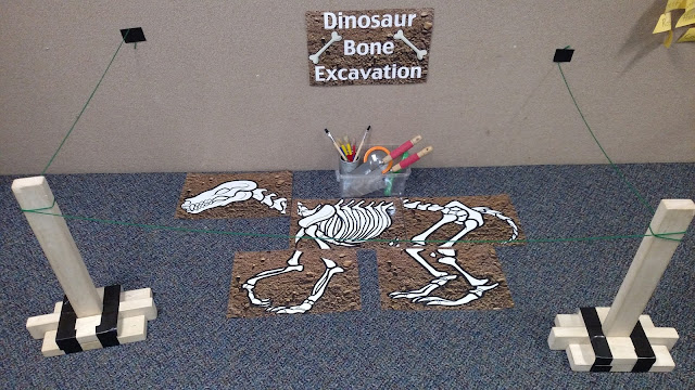 Dinosaur Excavation Sensory Experience | Apples to Applique