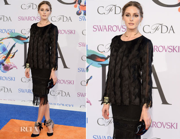 Olivia Palermo wore a black fringed dress by Ann Taylor with Aquazzura Madison sandals, Lulu Guinness clutch