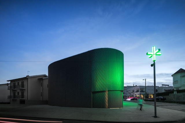 Picture of green light on the modern pharmacy building