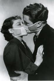 Couple with surgical masks kissing