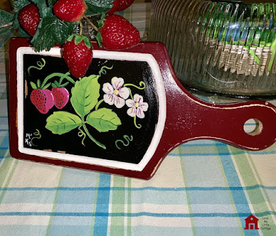 http://lovemylittlecottage.com/hand-painted-strawberry-cutting-board-craft-room-destash-challenge/