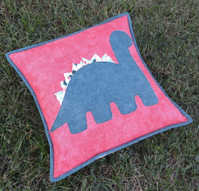 Selvage triangle dinosaur pillow