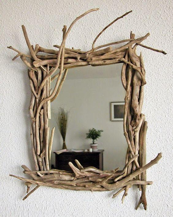 espejo decorado con palos