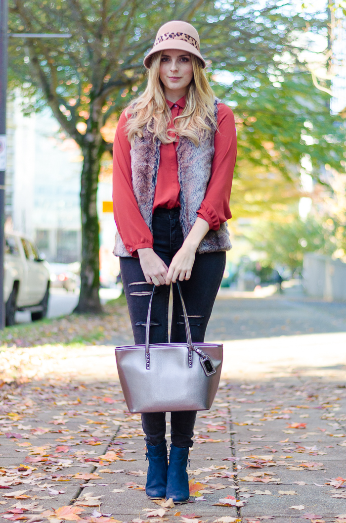 Pretty fall style in burnt orange blouse, Forever 21 vest and American Eagle ripped black denim
