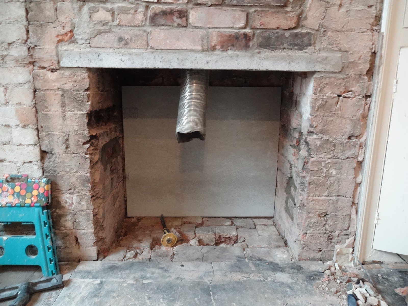 how to line the inside of a chimney behind wood burner