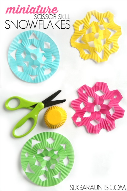 Practice scissor skills and provide proprioception with this miniature cupcake liner snowflakes craft for kids.