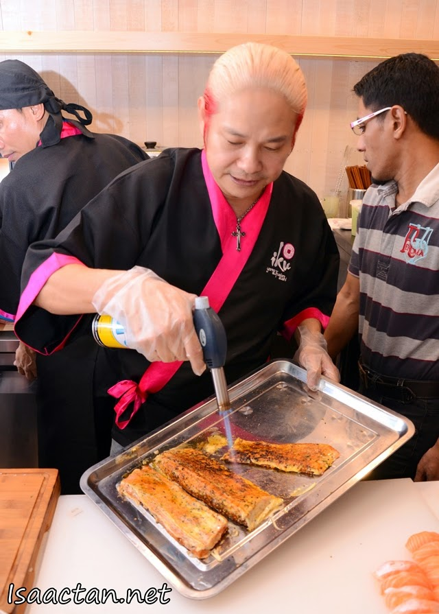 Chef Yama 'flaming' the salmon belly