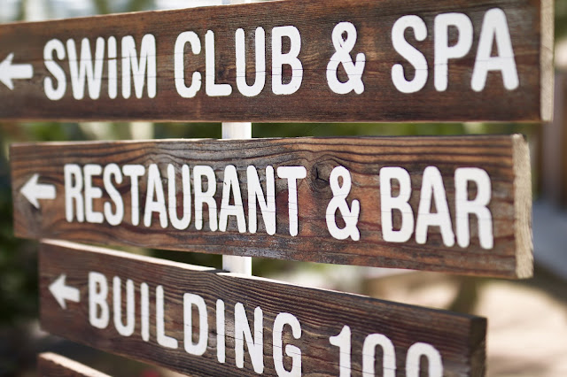 The Ace Hotel & Swim Club wooden direction signs