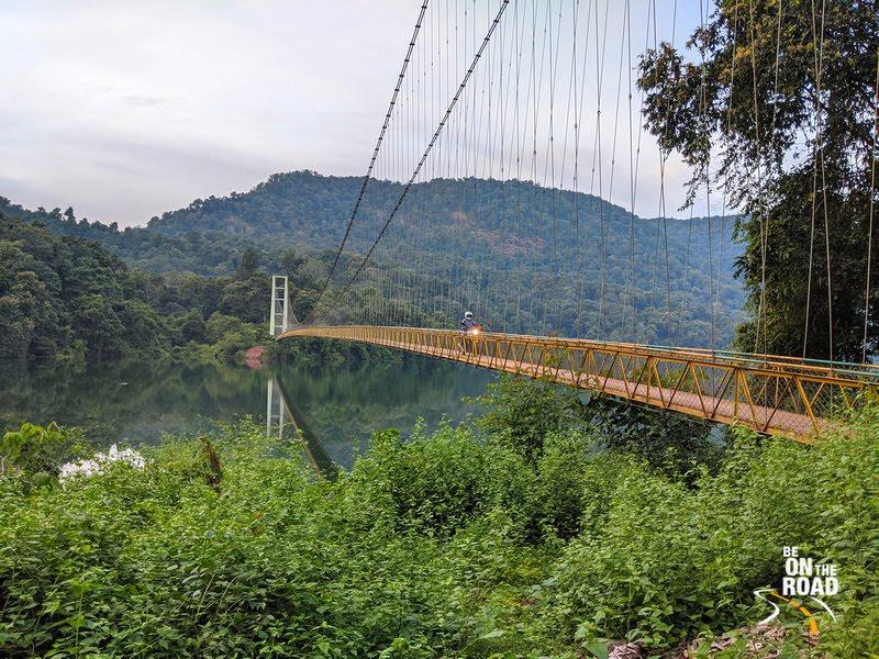 Crossing the Shivapura hanging bridge on motorcycle