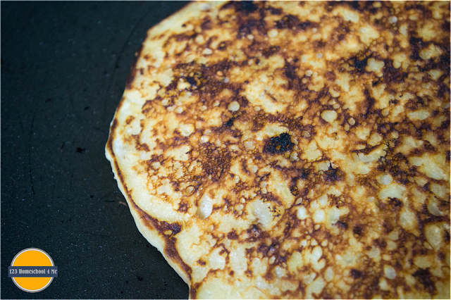 pour pancake batter onto warm griddle and cook until godlen brown