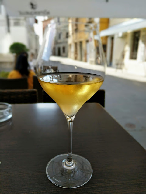 Glass of white wine at Manzioli wine bar in Izola Slovenia