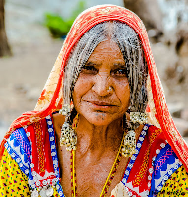 portrait of a tribal women wearing ethnic jewellery in Hampi