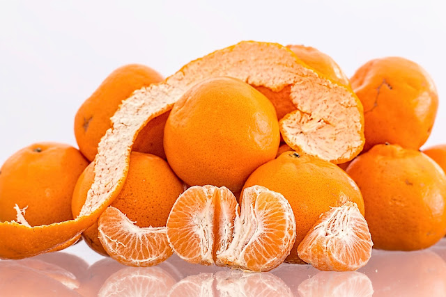 Tangerines, one is peeled