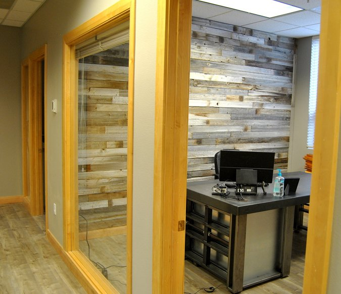 chiropractic office tour reclaimed wood wall