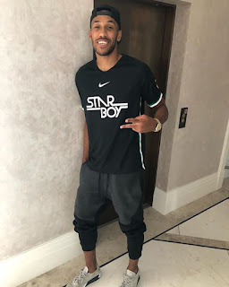 Arsenal Star  Aubameyang poses with Wizkid Star Boy shirt