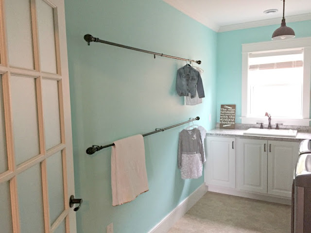 Using curtain rods as drying racks in a laundry room ...