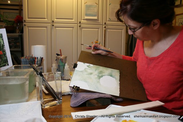 A photograph of beginning the watercolor background for Dancing Poppies.