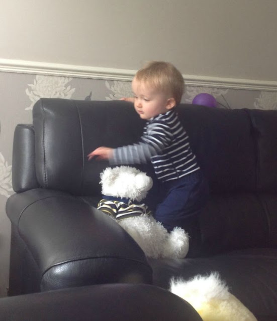 Baby walking along sofa