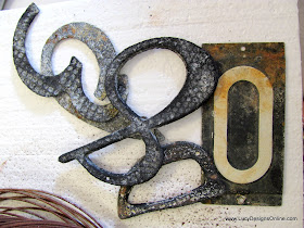 aged, rusty metal house numbers for art