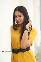 Actress Poojitha Stills in Yellow Short Dress at Darshakudu Movie Teaser Launch .COM 0085.JPG