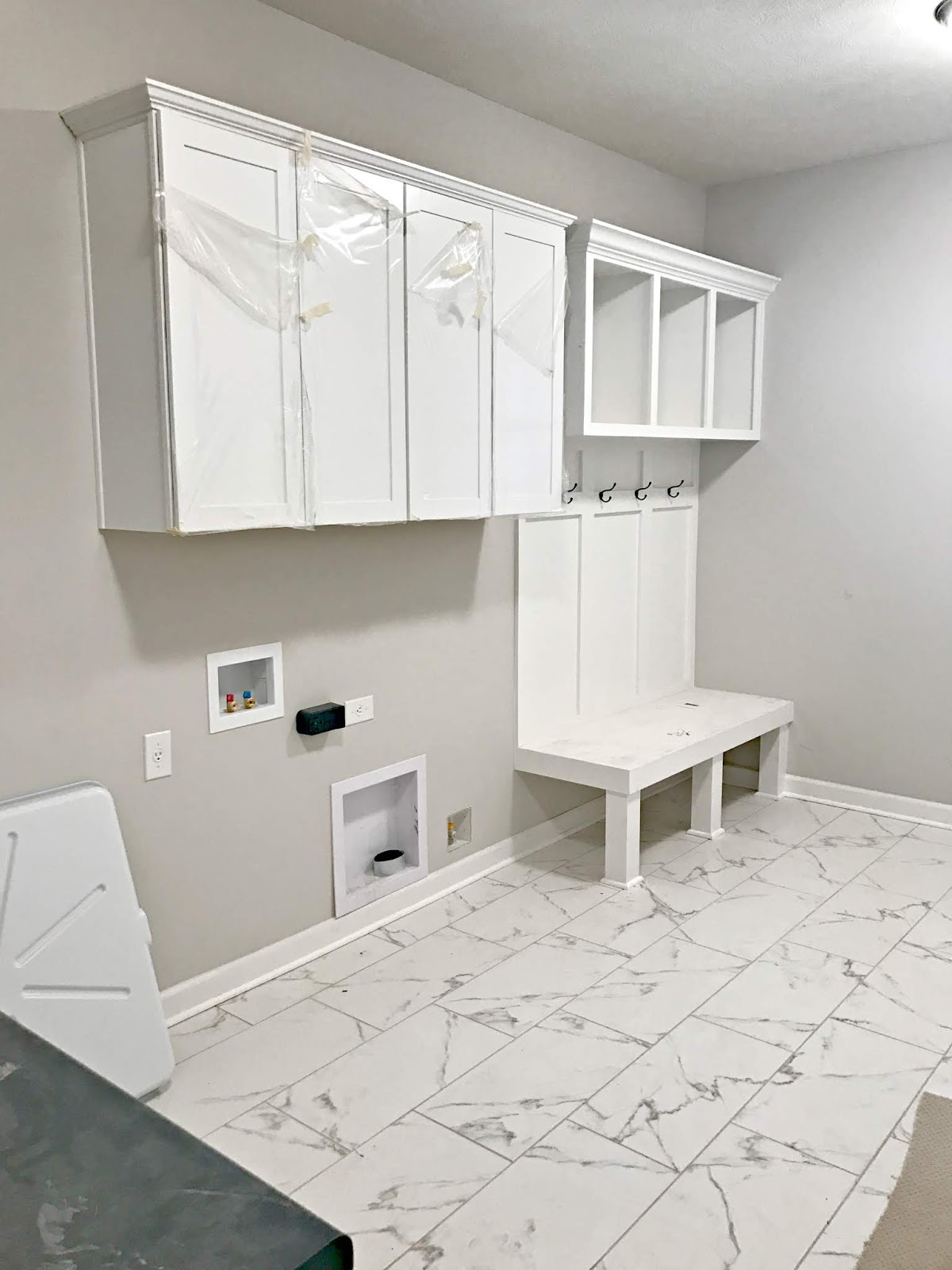 Combo mud and laundry room with built ins