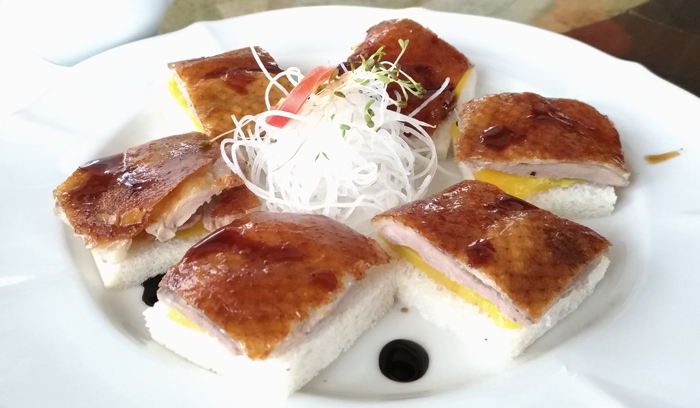 Crispy Fragrant Duck served with Fresh Mango