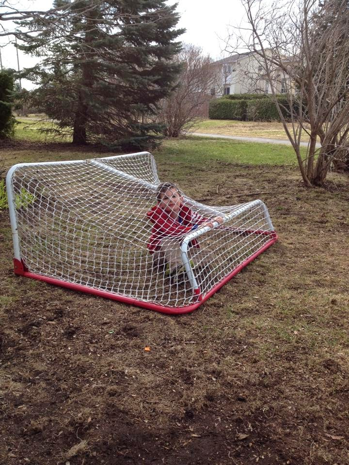 child in soccer net,