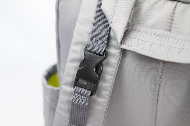 A close up photo of one of the stroller straps on the Forma Backpack