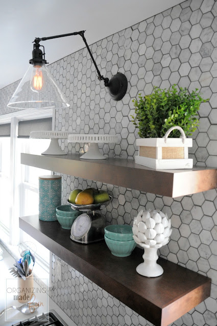 Floating shelves, clear glass shade sconce, carrara marble wall tile :: OrganizingMadeFun.com