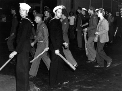 "U.S. armed forces personnel with wood clubs on street during ""zoot suit"" riot, Los Angeles 1943 Courtesy Library of Congress"