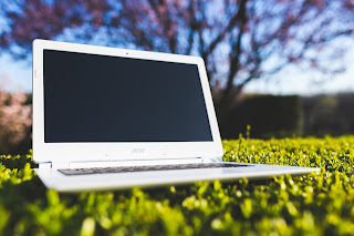image Chromebook sitting in a field
