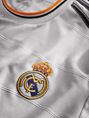 The new Real Madrid 2013-14 Home Kit short is white with dark grey adidas  stripes and a small orange stripe on the trouser waistband. 575534abc