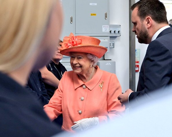 Queen Elizabeth II visited the new Highland Spring factory building in Blackford. The Queen style. wore pink coat and flower dress