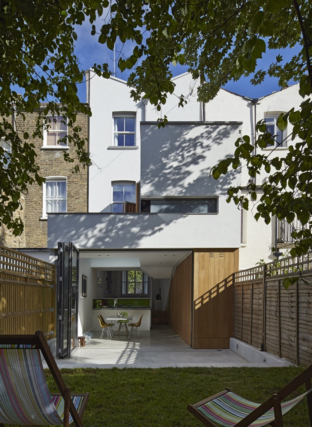 http://freshome.com/2014/01/08/clever-family-home-makeover-london-neil-dusheiko-architects/