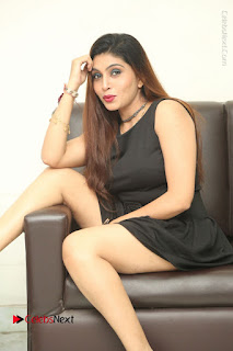 Tollywood Upcoming Actress Pooja Roshan Stills in Black Short Dress at Plus 1 Movie Trailer Launch  0263.JPG