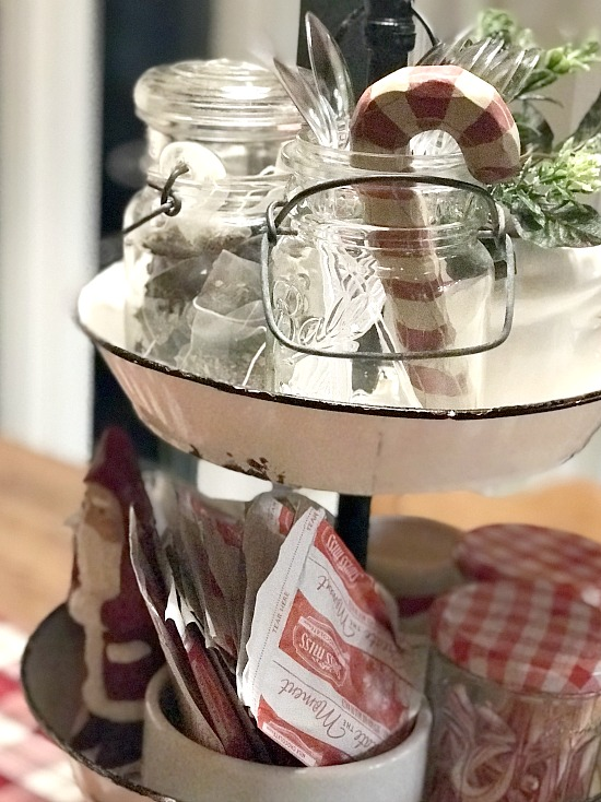Hot cocoa bar in an enamelware tiered tray