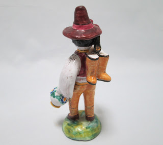 Czech Redware Figurine Back View Man with Jug and ax wearing hat