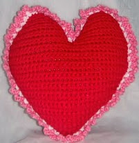 http://www.ravelry.com/patterns/library/free-pattern--heart-pillow